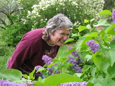 Jill Smelling Lilacs